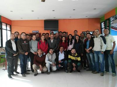 Agora Ambassador Lamichhane Shyam (8th from the right) and the members of the first club in Nepal - Kathmandu Speakers Club