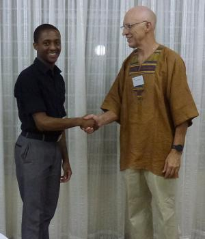 Chris Callaghan (right) -  Agora Ambassador and President of the Agora Speakers Queenswood Club in Pretoria, South Africa, greeting speaker Aaron Masemola (left).